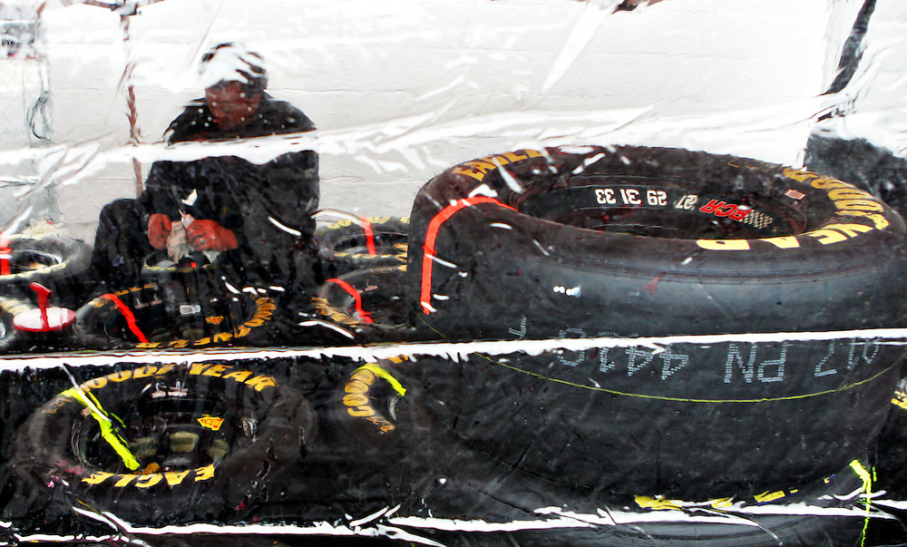 Apr 28, 2012; Richmond, VA, USA; NASCAR Sprint Cup pit crews prepare tires in a tent because of the rain before the Capital City 400 at Richmond International Raceway. Mandatory Credit: Peter Casey-US PRESSWIRE.
