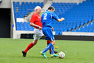 Tommy Charlton of England over 60's battles for possession with Pierluigi Rossi of Italy during the world's first Walking Football International match between England and Italy at the American Express Community Stadium, Brighton and Hove, England on 13 May 2018. Picture by Graham Hunt.