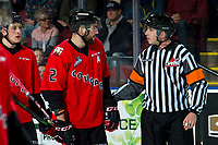 KELOWNA, BC - DECEMBER 30:  Cole Moberg #2 of the Prince George Cougars speaks to referee Mike Langin at the Kelowna Rockets at Prospera Place on December 30, 2019 in Kelowna, Canada. (Photo by Marissa Baecker/Shoot the Breeze)