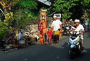 Villagers making their way to the village temple to join the celebration of Galungan. Galungan celebrates the victory of virtue (Dharma) over evil (Adharma) and is perhaps the most important religious holiday for Balinese Hindus. Sanur, Bali, Indonesia