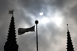 © Licensed to London News Pictures. 10/06/2021. London, UK. The moon passes in front of the sun during a partial eclipse viewed in central London at above Southwark Cathedral. Photo credit: Peter Macdiarmid/LNP