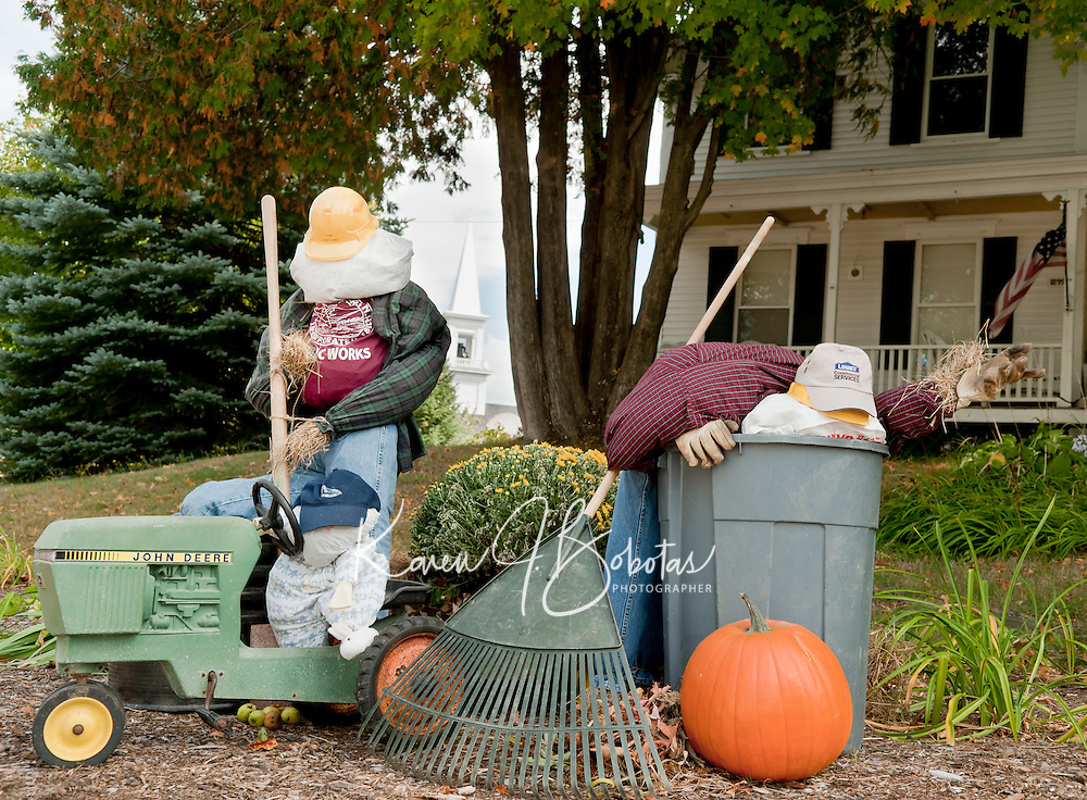 A scarecrow's work is never done.  Comical scarecrow displays were placed throughout Gilford Village to be judged as part of the 5th annual Heritage Festival celebration over the past weekend.  (Karen Bobotas/for the Laconia Daily Sun)