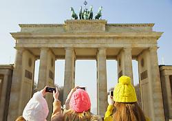 Three Girls Taking Photograph of the Brandenburg Gate, Berlin, Germany