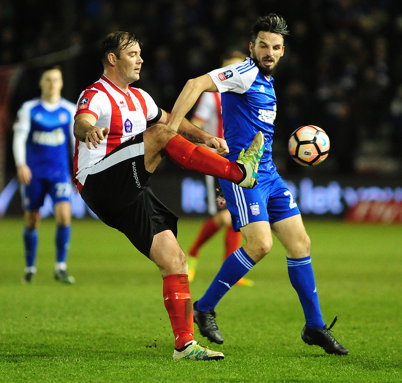Lincoln City's Matt Rhead vies for possession with Ipswich Town's Jonathan Douglas<br /> <br /> Photographer Andrew Vaughan/CameraSport<br /> <br /> Emirates FA Cup Third Round Replay - Lincoln City v Ipswich Town - Tuesday 17th January 2017 - Sincil Bank - Lincoln<br />  <br /> World Copyright © 2017 CameraSport. All rights reserved. 43 Linden Ave. Countesthorpe. Leicester. England. LE8 5PG - Tel: +44 (0) 116 277 4147 - admin@camerasport.com - www.camerasport.com