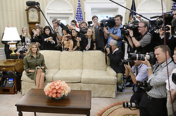 April 27, 2017 - Washington, District of Columbia, United States of America - First Lady  MELANIA TRUMP looks on during a meeting with President Mauricio Macri of Argentina in the Oval Office of the White House. (Credit Image: © Olivier Douliery/Pool/CNP via ZUMA Wire)