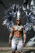 Hackney Carnival on 8th September 2019 in London, United Kingdom. Male dancer ready to take part.