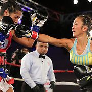 """Noemi """"NoNo"""" Bosques (red) and Yolaine LinDeLauf fight during a Telemundo boxing match at the A La Carte Pavilion on Friday, August 1, 2014 in Tampa, Florida. Bosques won the fight and the Women's Florida State Flyweight Title belt after dropping LinDeLauf three times. (AP Photo/Alex Menendez)"""