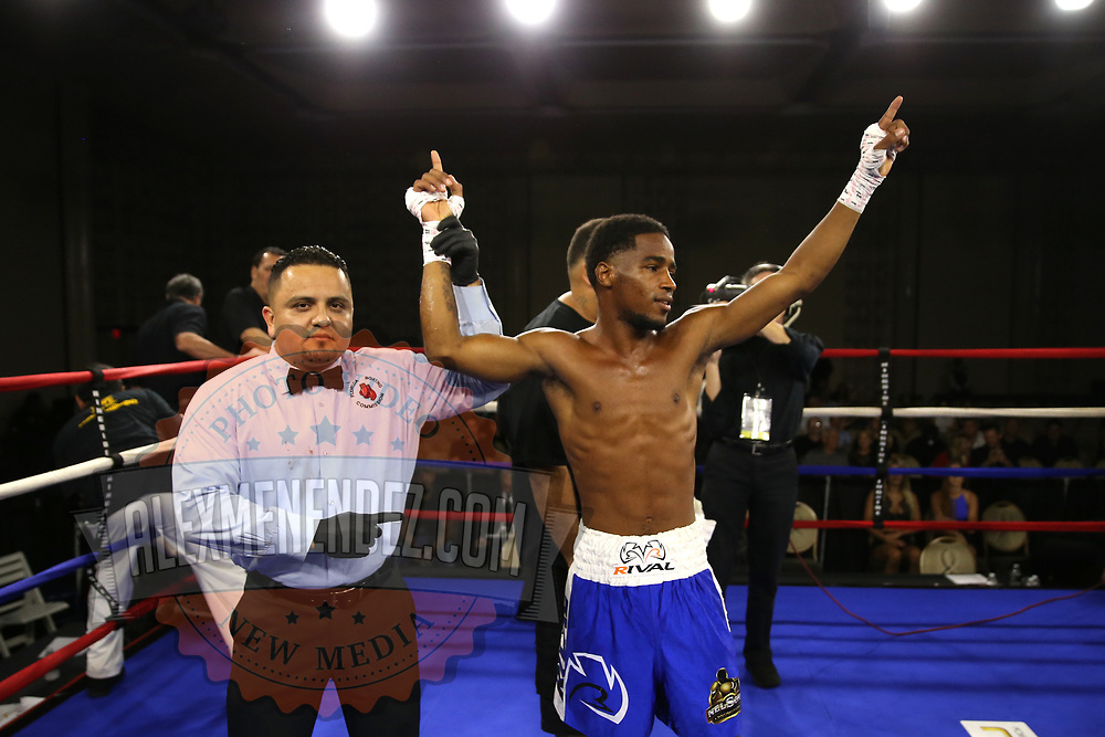 Dagoberto Aguero of San Cristobal, Dominican Republic raises his arms in victory after knocking out Gustavo Molina of Mexico during a Nelsons Promotions boxing match at the Boca Raton Resort  and Club on Friday, May 26, 2017 in Boca Raton, Florida.  (Alex Menendez via AP)