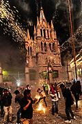 Residents scramble as they are pelted by pyrotechnic rockets in front of the Saint Michael Archangel church during the Alborada festival September 29, 2018 in San Miguel de Allende, Mexico. The unusual festival celebrates the cities patron saint with a two hour-long firework battle at 4am representing the struggle between Saint Michael and Lucifer.