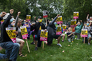 Anti-racist campaigners take a knee in solidarity with England footballers Marcus Rashford, Jadon Sancho and Bukayo Saka during an event on Ducketts Common organised by Haringey Stand Up To Racism on 15th July 2021 in London, United Kingdom. The three England footballers were subjected to racial abuse following Englands Euro 2020 final defeat against Italy.
