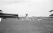 Player jumps to head ball during the All Ireland Senior Football Final Galway v. Kerry in Croke Park on the 26th September 1965. Galway 0-12 Kerry 0-09.