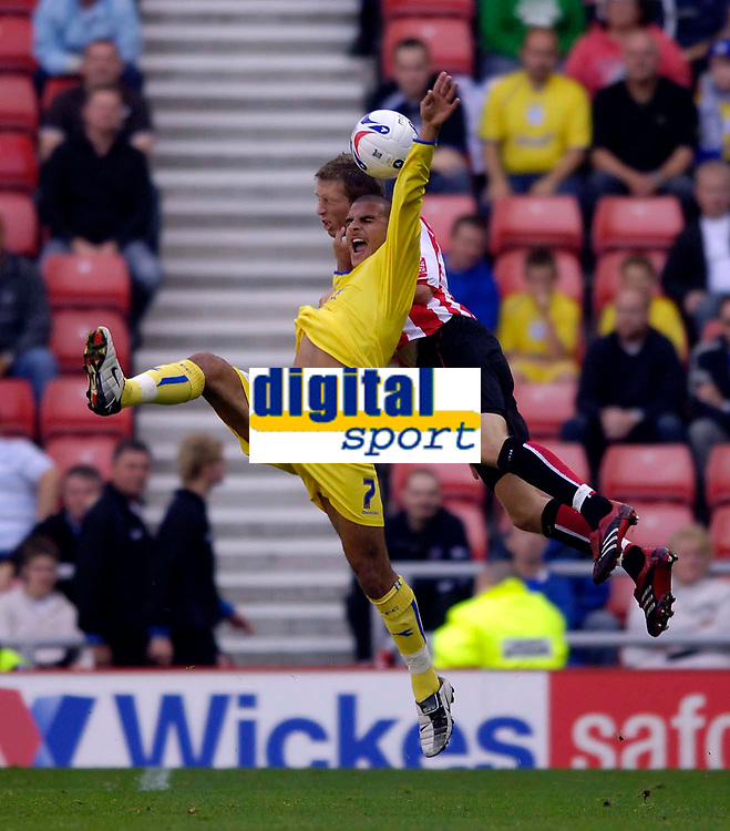 Photo: Jed Wee.<br />Sunderland v Sheffield Wednesday. Coca Cola Championship. 30/09/2006.<br /><br />Sheffield Wednesday's Marcus Tugay (L) jumps with Sunderland's Danny Collins.
