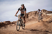 SHOT 10/14/16 4:05:07 PM - Biking down Murphy's Hogback on the White Rim Trail. The White Rim is a mountain biking trip in Canyonlands National Park just outside of Moab, Utah. The White Rim Road is a 71.2-mile-long unpaved four-wheel drive road that traverses the top of the White Rim Sandstone formation below the Island in the Sky mesa of Canyonlands National Park in southern Utah in the United States. The road was constructed in the 1950s by the Atomic Energy Commission to provide access for individual prospectors intent on mining uranium deposits for use in nuclear weapons production during the Cold War. Four-wheel drive vehicles and mountain bikes are the most common modes of transport though horseback riding and hiking are also permitted.<br /> (Photo by Marc Piscotty / © 2016)