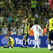 Fenerbahce's Mehmet TOPUZ (C) during their Turkish superleague soccer derby match Fenerbahce between Trabzonspor at the Sukru Saracaoglu stadium in Istanbul Turkey on Sunday 16 May 2010. Photo by TURKPIX