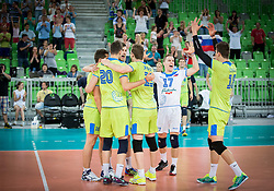 Players of Slovenia celebrate after winning during volleyball match between National teams of Slovenia and F.Y.R. Macedonia in Qualifications for 2015 CEV Volleyball European Championship - Men on May 24, 2014 in Arena Stozice, Ljubljana, Slovenia. Photo by Vid Ponikvar / Sportida