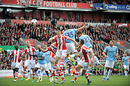 Manchester City's Stevan Jovetic heads for goal from a corner during the Barclays Premier league match, Stoke city v Manchester city at the Britannia Stadium in Stoke on Trent on Sat 14th Sept 2013. pic by Jeff Thomas, Andrew Orchard sports photography,