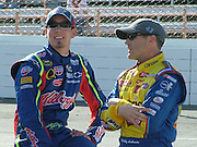 Kyle Busch and Bobby Labonte converse during qualifying for the Goody's Cool Orange 500 at Martinsville Speedway