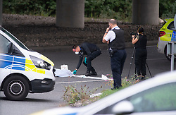 ©Licensed to London News Pictures 07/09/2020  Sidcup, UK. Forensic officers working. A man has fallen from the A20 Sidcup bypass bridge in South East London onto the road below which is Crittalls corner roundabout. Police are on scene. Photo credit: Grant Falvey/LNP