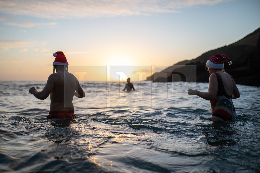 © Licensed to London News Pictures. 17/12/2020. St Austell, UK. People swim without wetsuits in the sea at Little Perhaver Beach, Cornwall, on a cold crisp morning. Photo credit : Tom Nicholson/LNP
