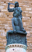 Copy of Judith and Holofernes, by Donatello. A sculpture outside of the entrance to the Palazzo Vecchio. Town hall of Florence, Italy. The original bronze sculpture by Donatello was made in 1460, but replaced by a bronze copy in the late 20th century. The original is the only surviving signed work by Donatello.