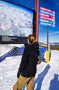 Snow boarder and Trail map, Mammoth Mountain Ski Area, Mammoth Lakes, California USA