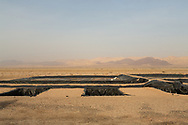 Man made water pools at the rear of the The Sahara Forest Project on the outskirts of Aqaba, on Jordan's southern Red Sea coastline. The farm uses desalinated sea water and greenhouses to sustainably farm crops in land that was once aris desert.