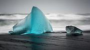 Large turquoise iceberg on Jökulsárlón beach, Iceland