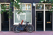 Bicycles and traditional architecture in the Jordaan trendy district of  Amsterdam, Holland