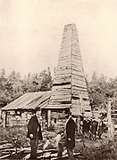 Drake Well, Pennsylvania, USA.  Edwin Laurentine 'Colonel' Drake (1819-1880) American oil driller,  said to have been the first to drill for oil.  Drake, in tall hat in centre of the picture, talking to his engineer while the labourers who have dug the well wait in the background. Oil was struck on 27 August 1859.  From 'All About Inventions and Discoveries' (London, 1916).