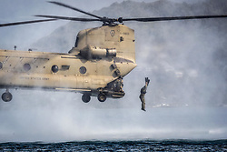 Apr 24, 2017 - Hawaii, U.S. - A Marine jumps out of a CH-47 Chinook during helocasting training operations as part of a reconnaissance team leader course at Marine Corps Base Hawaii, April 24, 2017. The course emphasized planning, briefing and leading teams in patrolling, ground reconnaissance and amphibious operations. Marine Corps photo by Gunnery Sgt. Ezekiel R. Kitandwe. (Credit Image: © Ezekiel R. Kitandwe/Marine Corps/DoD via ZUMA Wire/ZUMAPRESS.com)