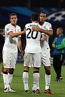 Patrice Evra (L, Robin van Persie (C) and Rio Ferdinand (D) of Manchester United celebrate after the UEFA Champions League, Group H, soccer match against CFR Cluj, at Dr. Constantin Radulescu Stadium in Cluj-Napoca, Romania, 2 October 2012.