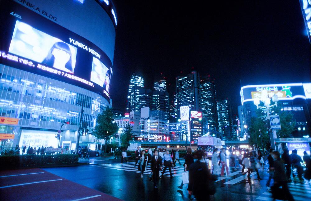 Shinjuku street at night, Tokyo, Japan.