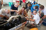Teams bestuderen de VeloX IV tijdens de technische keuring. Het Human Power Team Delft en Amsterdam (HPT), dat bestaat uit studenten van de TU Delft en de VU Amsterdam, is in Duitsland voor een poging het uurrecord te verbreken op de Dekrabaan met de VeloX4. In september wil het HPT daarna een poging doen het wereldrecord snelfietsen te verbreken, dat nu op 133 km/h staat tijdens de World Human Powered Speed Challenge.<br /> <br /> The Human Power Team Delft and Amsterdam, consisting of students of the TU Delft and the VU Amsterdam, is in Germany for the attempt to set a new hour record on a bicycle with the special recumbent bike VeloX4. They also wants to set a new world record cycling in September at the World Human Powered Speed Challenge. The current speed record is 133 km/h.