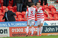 Doncaster Rovers forward John Marquis celebrates as he scores his first goal of the match 1-0 with Doncaster Rovers defender Danny Andrew during the EFL Sky Bet League 1 match between Doncaster Rovers and Bradford City at the Keepmoat Stadium, Doncaster, England on 22 September 2018.