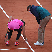 PARIS, FRANCE September 28.  Katarina Zavatska of The Ukraine argues a line call with the umpire during her match against Kiki Bertens of The Netherlands in the first round of the singles competition on CourtSuzanne Lenglen during the  French Open Tennis Tournament at Roland Garros on September 28th 2020 in Paris, France. (Photo by Tim Clayton/Corbis via Getty Images)