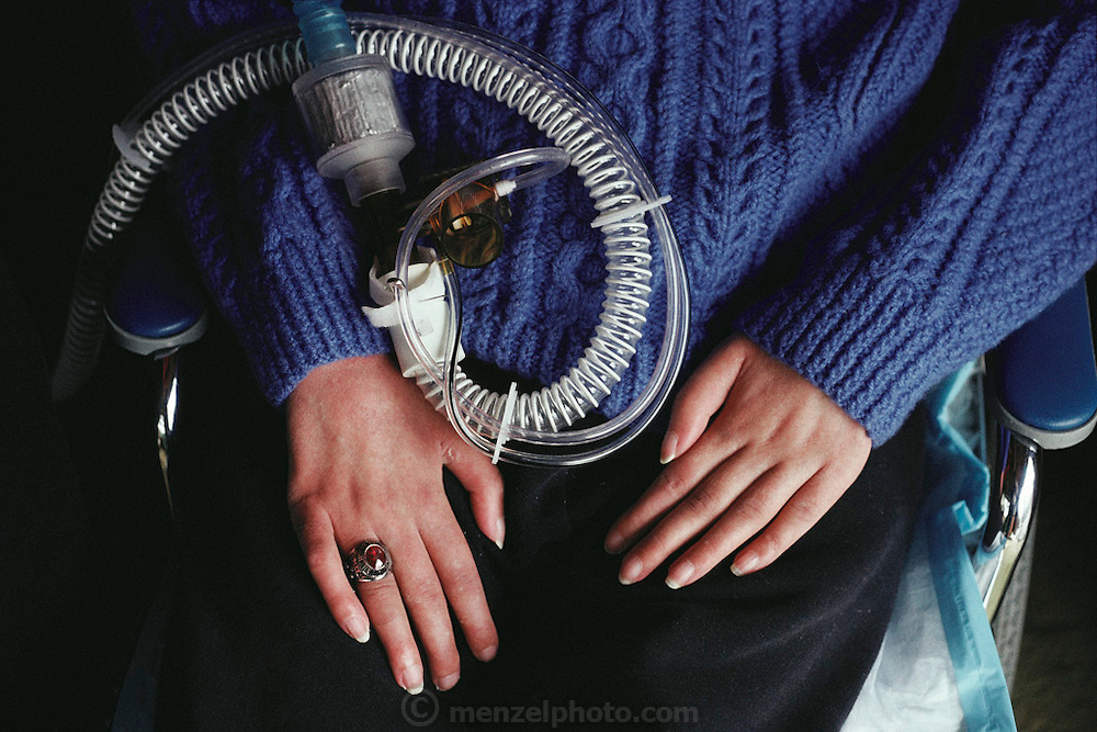 Medicine: Dr. Lance Meagaer, a patient with Amyotrophic Lateral Sclerosis (ALS), is linked to the computer by a microchip in his skull. By looking at the screen he can control the computer. Seen at home in Cannon Beach, Oregon (view of his hands and breathing tube). (1988)