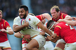 Billy Vunipola of England takes on the Wales defence - Mandatory byline: Patrick Khachfe/JMP - 07966 386802 - 12/03/2016 - RUGBY UNION - Twickenham Stadium - London, England - England v Wales - RBS Six Nations.