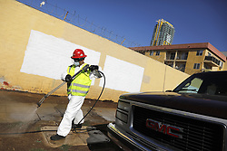 September 11, 2017 - San Diego, CA, United States - Jose Salinas, with Clean Harbors sprays a bleach solution on a downtown San Diego street often used by the homeless to live. The City of San Diego began cleaning certain streets downtown after an outbreak of the virus Hepatitis A has caused 15 deaths.   It is spread by sexual contact, eating, drinking or sharing utensils with an infected person. (Credit Image: © John Gastaldo via ZUMA Wire)