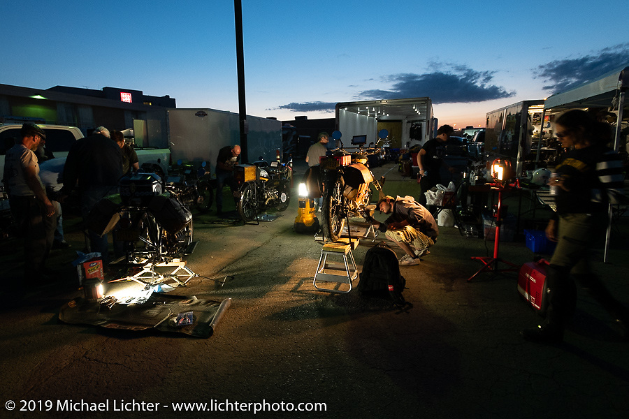 Loring Hill works on a 4-cylinder Henderson during the Motorcycle Cannonball coast to coast vintage run. Stage 10 (299 miles) from Sturgis, SD to Billings, MT. Tuesday September 18, 2018. Photography ©2018 Michael Lichter.