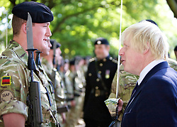 © licensed to London News Pictures.15/09/11. Putney. Mayor Boris Johnson talks to the troops. UK Soldiers from the Tidworth based 2nd Royal Tank Regiment, who served in Afghanistan over the winter,  march through Putney and meet London Mayor Boris Johnson. They ended their march in Wandsworth Park where some of the vehicles used in Afghanistan were displayed. Photo credit should read: Tim Roberts/LNP