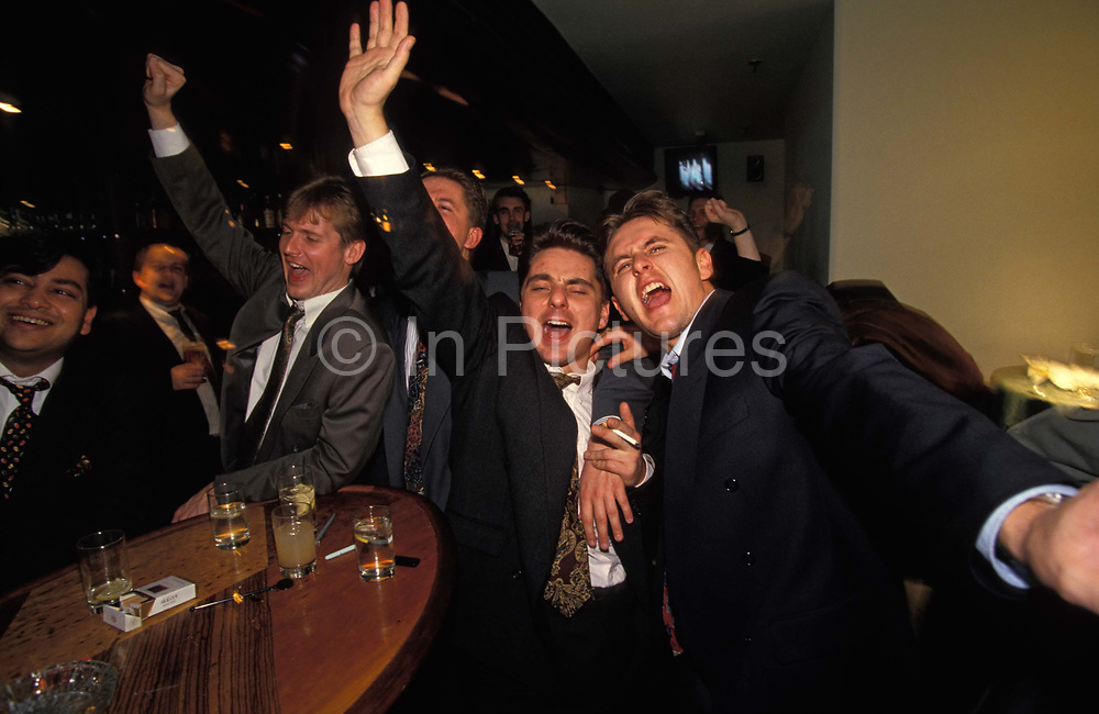 A group of young men sing karaoke at Coates Wine Bar on London Wall in the City of London, the capitals financial district, on 18th December 1993, in London, England.