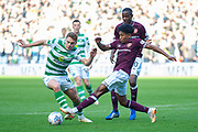 Demetri Mitchell (#11)  of Heart of Midlothian tackles James Forrest (#49) of Celtic FC during the Betfred League Cup semi-final match between Heart of Midlothian FC and Celtic FC at the BT Murrayfield Stadium, Edinburgh, Scotland on 28 October 2018.