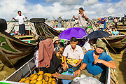 13 JUNE 2013 - YANGON, MYANMAR:     Boatmen and passengers at the Aung Mingalar Jetty in Yangon. The jetty is a stop for commuters who live on the far side of the Irrawaddy River and ride small boats back and forth across the river. Yangon, formerly Rangoon, is Myanmar's commercial capital and used to be the national capital. The city is on the Irrawaddy River and has a vibrant riverfront.    PHOTO BY JACK KURTZ
