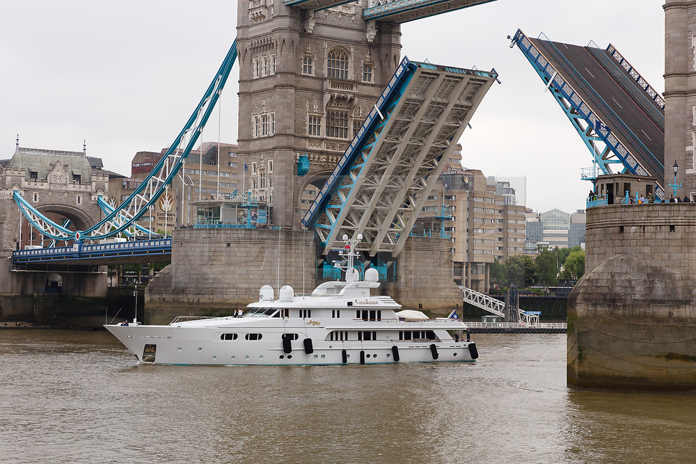 © Licensed to London News Pictures. 16/05/2018. London, UK. Superyacht, Lady M II passes under Tower Bridge this morning before mooring next to HMS Belfast. The 164 feet long superyacht, Lady M II (previously named Lady M) is rumoured to be owned by politician and businessman, Lord Ashcroft. A different superyacht, called Lady M visited Glasgow and Cumbria last year and was reported to be owned by Russia's richest Billionaire, Alexi Mordashov. Lady M II sleeps up to 11 guests in 6 rooms and is also capable of carrying up to 12 crew onboard. Lady M II was designed by Donald Starkeywith various luxuries onboard, including a deck jacuzzi and is advertised for charter at USD180,000 per week plus expenses. Photo credit: Vickie Flores/LNP