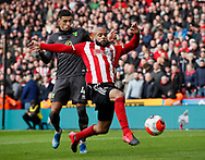 David McGoldrick of Sheffield Utd stretches to control the ball in front of Ben Godfrey of Norwich City  during the Premier League match at Bramall Lane, Sheffield. Picture date: 7th March 2020. Picture credit should read: Simon Bellis/Sportimage