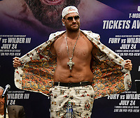 """Tyson """"The Gypsy King"""" Fury shows some fashion at the start of a Los Angeles press conference on his up coming 3rd fight with   Deontay Wilder, Tuesday, Los Angeles CA.USA. June 15,2021<br /> The two will fight on Saturday, July 24, headlining a pay-per-view event live from T-Mobile Arena in Las Vegas NV(Photo by Gene Blevins)"""