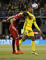 November 21, 2017 - Columbus, OH, USA - Columbus Crew forward Ola Kamara (11) heads a ball away from Toronto FC defender Drew Moor (3) during the first half of the first leg of the MLS Eastern Conference finals at MAPFRE Stadium in Columbus, Ohio, on Tuesday, Nov. 21, 2017. (Credit Image: © Adam Cairns/TNS via ZUMA Wire)