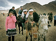 Young teenagers come by horse from nearby Olgii town to see the festival... and flirt a little.<br /> <br /> Eagle Hunting festival in Western Mongolia, in the province of Bayan Olgii. Mongolian and Kazak eagle hunters come to compete for 2 days at this yearly gathering. Mongolia