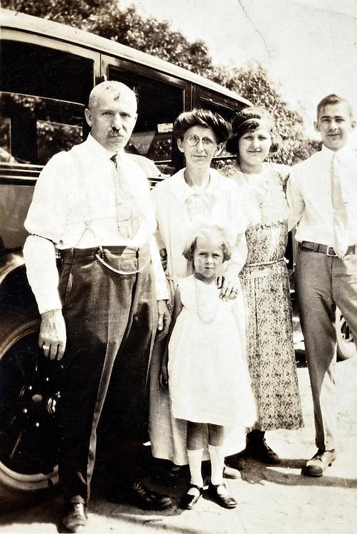 3 generation posing with car 1925 USA