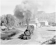 """D&RGW #493 heading south from the Graden flour mill siding.<br /> D&RGW  Durango, CO  Taken by Springer, Fred M. - 3/31/1958<br /> In book """"Durango: Always a Railroad Town (1st ed.)"""" page 61"""
